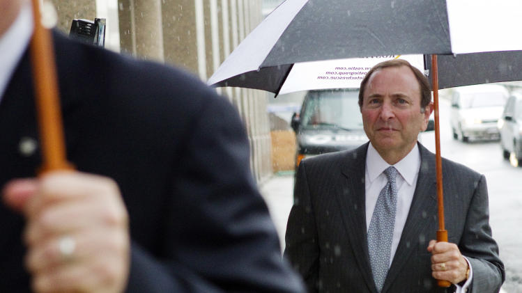 NHL Commissioner Gary Bettman leaves the NHL Players' Association's offices following collective bargaining talks, Tuesday, Aug. 14, 2012, in Toronto. (AP Photo/The Canadian Press, Chris Young)