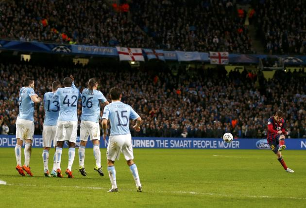 Barcelona's Lionel Messi takes a free kick against Manchester City during their Champions League round of 16 first leg soccer match at the Etihad Stadium in Manchester