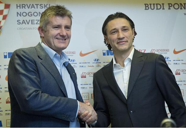 Newly appointed head coach of Croatia's national soccer team Niko Kovac, right, shakes hands with Davor Suker, head of the Croatian Soccer Federation, after a news conference in Zagreb, Croatia, Thurs