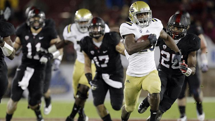 UCLA running back Johnathan Franklin (23) dashes for a 51-yard touchdown against Stanford during the first half of the Pac-12 championship NCAA college football game in Stanford, Calif., Friday, Nov. 30, 2012. (AP Photo/Tony Avelar)