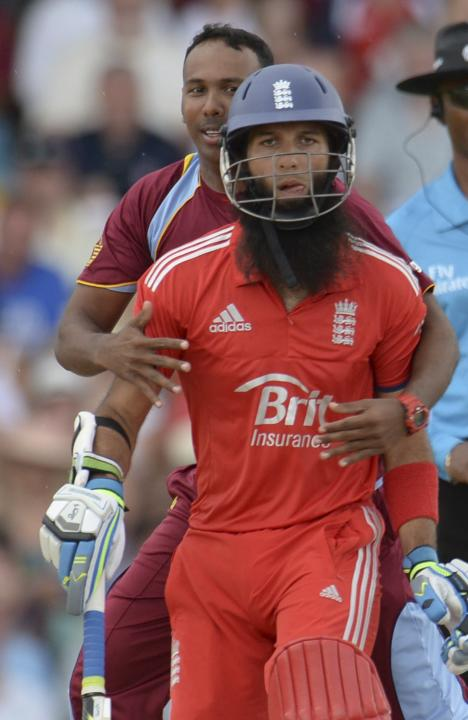 West Indies' Badree holds England's Ali during their second T20 international cricket match in Barbados