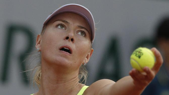Russia's Maria Sharapova serves against Su-Wei Hsieh of Taipei in their first round match of the French Open tennis tournament, at Roland Garros stadium in Paris, Monday, May 27, 2013. (AP Photo/Michel Spingler)