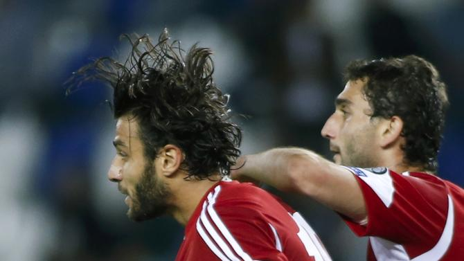 Georgia's Okriashvili celebrates with his team mate Vatsadze after scoring penalty against Gibraltar during their Euro 2016 qualifying soccer match in Tbilisi