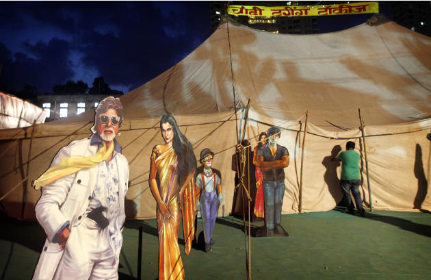 In this April 20, 2013 photo, cut outs of Indian Bollywood stars are displayed on the premises of the Anup Touring Talkies tent cinema in Mumbai, India. Friday, May 3 marks exactly a hundred years aft