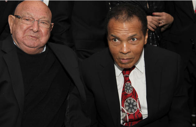 Muhammad Ali, right, celebrates his 70th birthday next to his longtime trainer Angelo Dundee, at a fund raiser for the Muhammad Ali Center in his hometown of Louisville, Ky., on Saturday, Jan. 14, 201