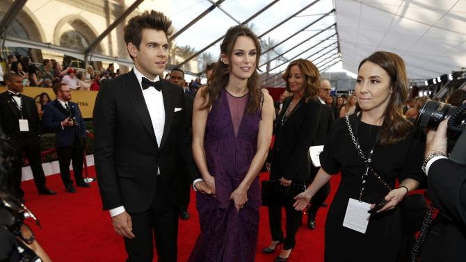 Actress Kiera Knightley arrives with her husband James Righton at the 21st annual Screen Actors Guild Awards in Los Angeles
