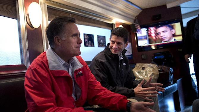 Republican presidential candidate, former Massachusetts Gov. Mitt Romney, right, talks with his vice presidential running mate Rep. Paul Ryan, R-Wis., on his campaign bus after a rally on Tuesday, Sept. 25, 2012 in Vandalia, Ohio.  (AP Photo/ Evan Vucci)