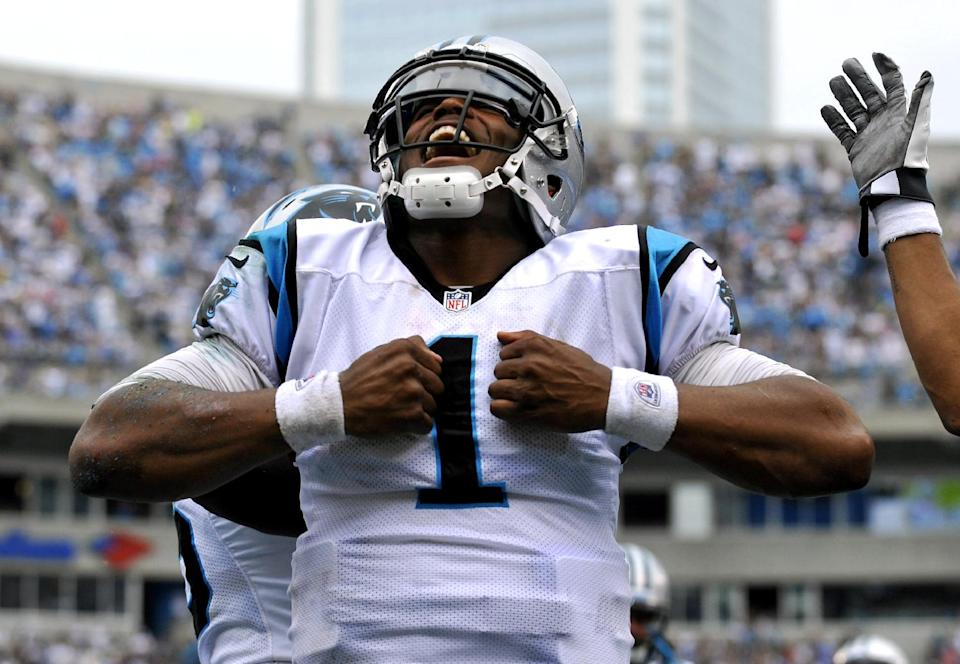 Carolina Panthers' Cam Newton (1) reacts after running for a touchdown against the New Orleans Saints during the fourth quarter of an NFL football game in Charlotte, N.C., Sunday, Sept. 16, 2012. The Panthers won 35-27. (AP Photo/Rainier Ehrhardt)