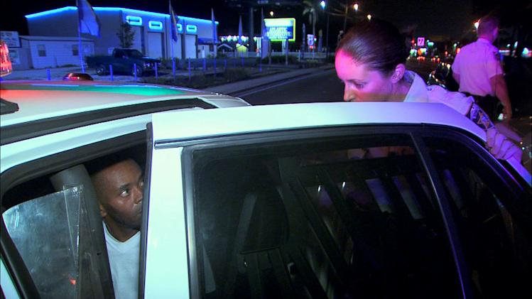 "A suspect is questioned as seen on ""Cops."""