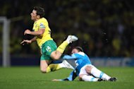 Norwich City's Wesley Hoolahan (left) is fouled by Sunderland's Craig Gardner during their English Premier League match at Carrow Road, Norwich, Monday Sept. 26, 2011. (AP Photo / Chris Radburn/PA) UNITED KINGDOM OUT NO SALES NO ARCHIVE