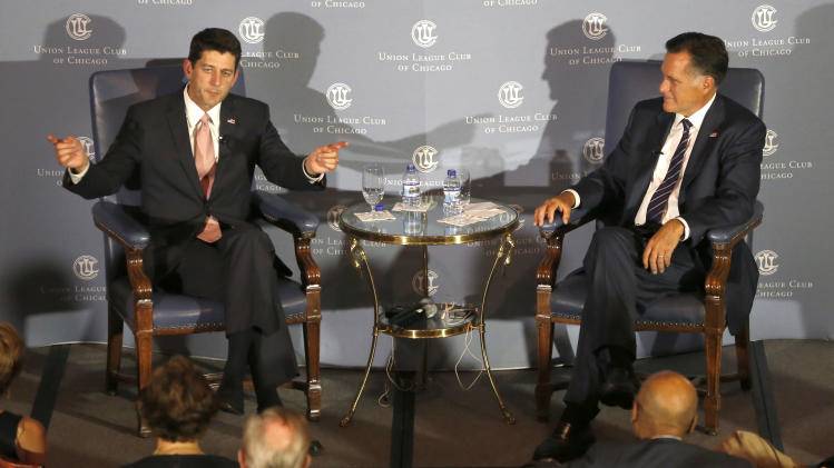 """Former Massachusetts Gov. Mitt Romney, right, listens to the response of his former vice-presidential running mate U.S. Rep. Paul Ryan, R-Wis., during an interview about Ryan's new book, """"The Way Forward: Renewing the American Idea."""" during an event at the Union League Club Thursday, Aug. 21, 2014, in Chicago. Ryan is on tour to promote the book as he weighs a presidential campaign of his own. (AP Photo/Charles Rex Arbogast)"""