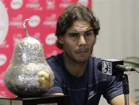 Nadal speaks during a news conference after winning his men's singles final match against Ferrer at the Acapulco International tennis tournament in Acapulco