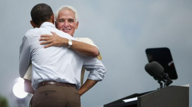 Former Florida Gov. Charlie Crist embraces President Obama during a campaign rally at St. Petersburg College, on Sept. 8.