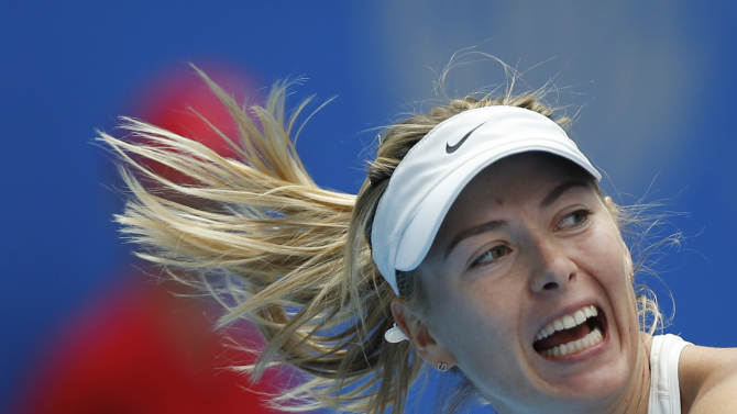 Hair flies as Maria Sharapova of Russia reacts during her match against Elina Svitolina of Ukraine during the China Open tennis tournament at the National Tennis Stadium in Beijing, China, Monday, Sept. 29, 2014. (AP Photo/Vincent Thian)
