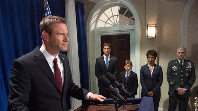 """This film image released by FilmDistrict shows, from left, Aaron Eckhart, Gerard Butler, Finley Jacobsen, Angela Bassett and Robert Forster in a scene from """"Olympus Has Fallen."""" (AP Photo/FilmDistrict, Phil Caruso)"""
