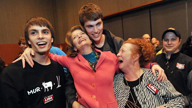 FILE - In htis Nov. 2, 2010, file photo Republican Sen. Lisa Murkowski, R-Alaska, celebrates early election returns in Anchorage, Alaska, with her sons, from left, Matt and Nick Murkowski, and longtime friend Hope Neslon, right. Murkowski ran as a write-in and won re-election in a three-way race with 39 percent of the vote, keeping the Senate seat she and father, Frank, had held for nearly three decades. It was the first time a senator had won as a write-in candidate since South Carolina's Strom Thurmond did it in 1954. (AP Photo/Michael Dinneen, File)
