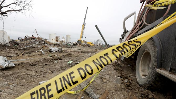 Investigators work at the site of a destroyed fertilizer plant in West, Texas, Thursday, May 2, 2013. Investigators face a slew of challenges in figuring out what caused the explosion at the fertilizer plant that killed 14 people and destroyed part of the small Texas town. (AP Photo/LM Otero, Pool)