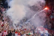 A flare is fired from a stand of Croatian supporters during their side's Euro 2012 match against Ireland in Poznan on June 10. Croatia are facing possible sanction after their fans lit flares and let off smoke bombs to celebrate two first-half goals in their opening Euro 2012 match against the Republic of Ireland, UEFA said on Tuesday