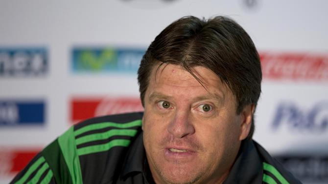 Mexico's coach Miguel Herrera talks to the press before a training session in Santos, Brazil, Friday, June 20, 2014. Mexico plays in group A at the 2014 soccer World Cup. (AP Photo/Eduardo Verdugo)