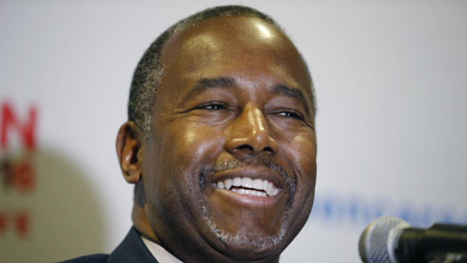 In this Nov. 23, 2015 photo, Republican presidential candidate, Dr. Ben Carson holds a news conference after a rally in Pahrump, Nev.  For many African Americans _ the vast majority of them Democrats _ there are two Carsons: one a genius doctor, and an inspirational speaker and writer who talks of limitless horizons, and the other a presidential candidate whose conservative politics have rocketed him to the top of the Republican primary polls.    (AP Photo/John Locher)