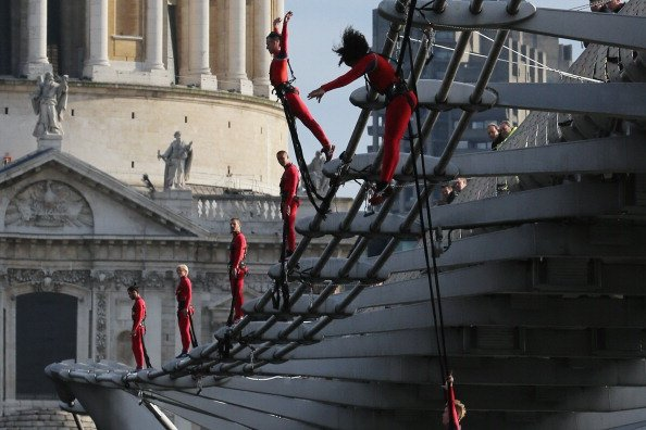 Dancers bungee off the Millennium Bridge as part of the 'One Extraordinary Day' performances on July 15, 2012 in London, England. The dancers are part of American choreographer Elizabeth Streb's 'extr