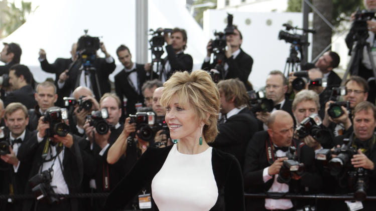 "FILE - This May 17, 2012 file photo shows actress Jane Fonda arrives for the screening of Rust and Bone at the 65th international film festival, in Cannes, southern France. Stella McCartney dress _ or dresses. McCartney, no stranger to the red carpet, has created a style that celebrities can't get enough of. Her ultra-flattering ""silhouette"" dress has become almost ubiquitous. It features one color on the bodice and back, and a graphic opposite on the sides and sleeves. Kate Winslet has worn several versions, and Brooklyn Decker, Kate Moss, Edie Falco and Liv Tyler have, too. The best turn might have been Jane Fonda at the Cannes Film Festival. (AP Photo/Lionel Cironneau, file)"