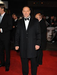 Russell Crowe said director Tom Hooper wanted vocal performances in Les Mis to be 'raw and real'