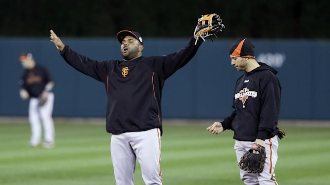 San Francisco Giants third baseman Pablo Sandoval, left, and second baseman Marco Scutaro warm up during a workout at Comerica Park in Detroit, Friday, Oct. 26, 2012. The Giants are scheduled to play the Detroit Tigers in Game 3 of baseball's World Series on Saturday in Detroit, with the Giants up 2-0 in the series. (AP Photo/Paul Sancya)