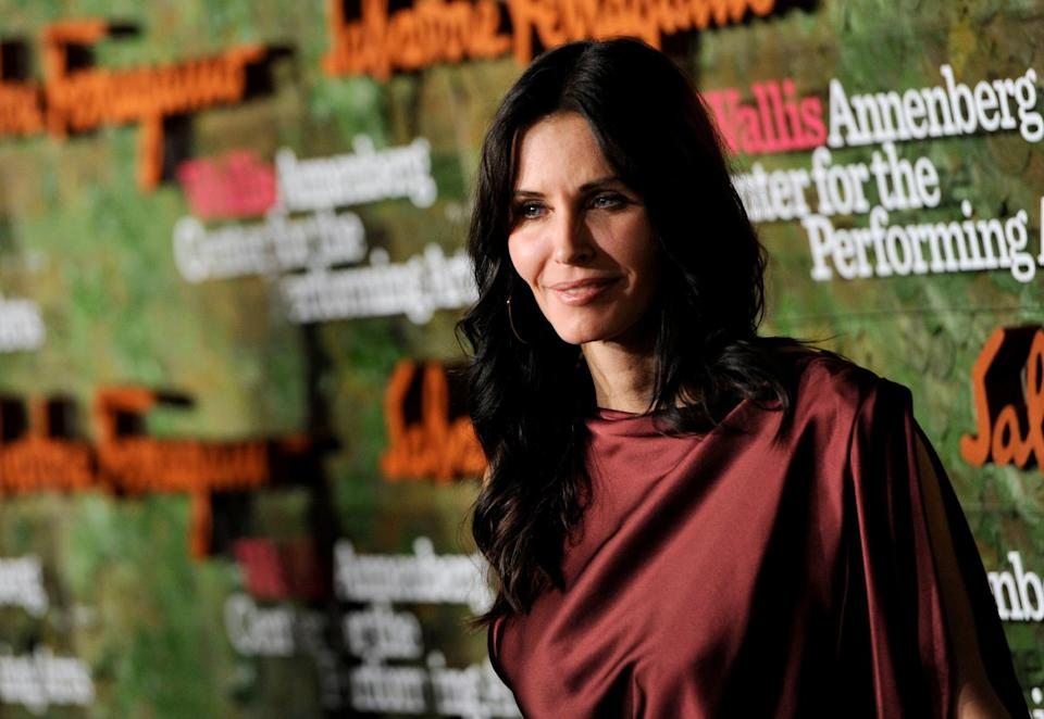 Actress Courteney Cox arrives at the Wallis Annenberg Center for the Performing Arts Inaugural Gala on Thursday, Oct. 17, 2013, in Beverly Hills, Calif. (Photo by Chris Pizzello/Invision/AP)