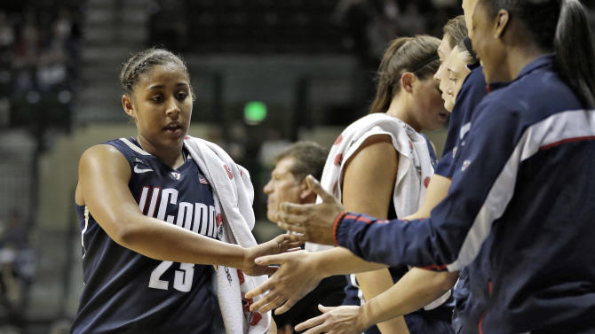 Connecticut forward Kaleena Mosqueda-Lewis (23) shakes hands with teammates after being taken out of the game during the second half of an NCAA women's college basketball game against South Florida Saturday, March 2, 2013, in Tampa, Fla. Mosqueda-Lewis scored 32 in UConn's 85-51 win. (AP Photo/Chris O'Meara)