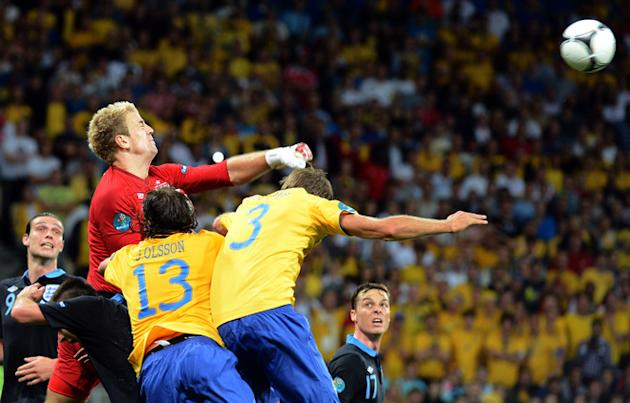 English Goalkeeper Joe Hart (L) Boxes AFP/Getty Images