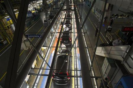 Production Associates inspect cars moving along assembly line at Honda manufacturing plant in Alliston, Ontario.