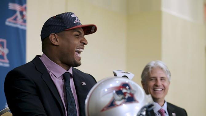Newly signed defensive end Sam and general manager Popp laugh during a news conference by the Montreal Alouettes CFL football team in Montreal