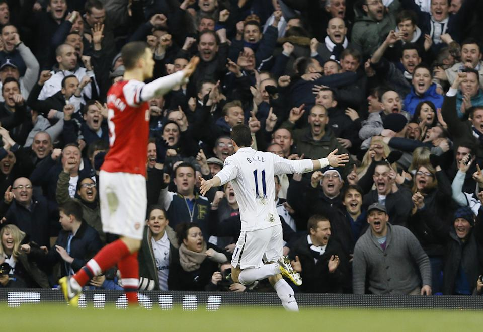 Tottenham Hotspur's Gareth Bale, right, celebrates after scoring a goal against Arsenal during the English Premier League soccer match between Tottenham and Arsenal at Tottenham's White Hart Lane stadium in London, Sunday, March  3, 2013. (AP Photo/Kirsty Wigglesworth)