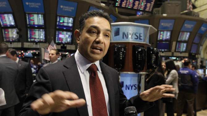 FILE - In this Tuesday, Jan. 4, 2011 file photo, Sanjay Jha, Chairman and CEO of Motorola Mobility, is interviewed on the floor of the New York Stock Exchange after his company's stock began trading. Jha is one of the top 10 highest paid CEOs at publicly held companies in America last year, according to calculations by Equilar, an executive compensation data firm, and The Associated Press. The Associated Press formula calculates an executive's total compensation during the last fiscal year by adding salary, bonuses, perks, above-market interest the company pays on deferred compensation and the estimated value of stock and stock options awarded during the year. (AP Photo/Richard Drew, File)