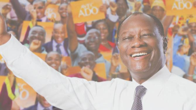 Ivory Coast's President Alassane Ouattara of the Rally of the Houphouetists for Democracy and Peace (RHDP) party waves as he arrives for a campaign rally at Jean Paul II space in Yamoussoukro