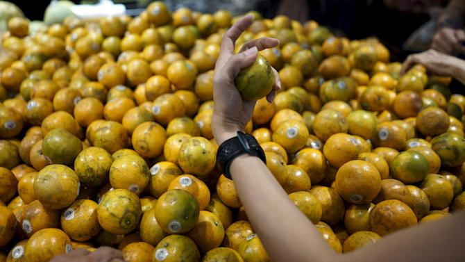 People shop for tangerines at a shopping mall ahead of the Chinese Lunar New Year celebrations in Bangkok, Thailand