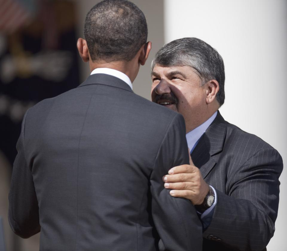 AFL-CIO President Richard Trumka talks to President Barack Obama in the Rose Garden of the White House in Washington, Wednesday, Aug. 31, 2011, where the president urged Congress to pass a federal highway bill.  (AP Photo/Evan Vucci)