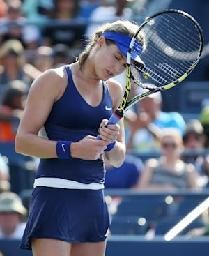 Dizzy in heat, Bouchard out of upset-heavy US Open