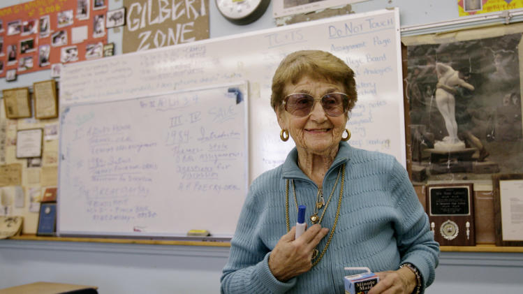 FILE - This Feb. 6, 2007 file photo shows Octogenarian teacher Rose Gilbert, 88, in her Advance Placement English Literature  class at the Pacific Palisades High School in Pacific Palisades, Calif. One of the oldest full time schoolteachers in the nation has retired at the age of 94. Gilbert has been teaching since 1956. (AP Photo/Damian Dovarganes, file)