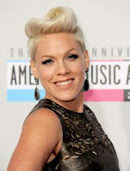 Pink arrives at the 40th Anniversary American Music Awards on Sunday, Nov. 18, 2012, in Los Angeles. (Photo by Jordan Strauss/Invision/AP)