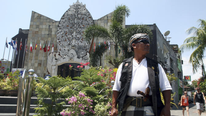 A Balinese security guard stands at the Bali Memorial Monument, where victims killed in the 2002 Bali bombings are honored, in Kuta, Bali, Indonesia on Thursday, Oct. 11, 2012. Indonesian police on Wednesday warned of a possible terrorist threat targeting dignitaries planning to commemorate Friday's 10th anniversary of the Bali bombings, raising the country's security alert to its highest level. (AP Photo/Firdia Lisnawati)