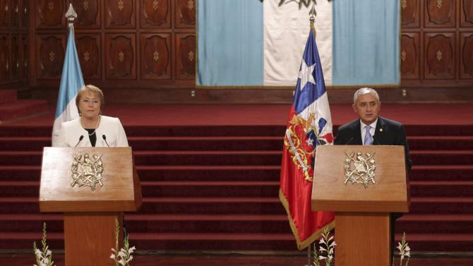 Chile's President Bachelet speaks at a news conference with Guatemala's President Perez, after a welcoming ceremony in the presidential palace in Guatemala City