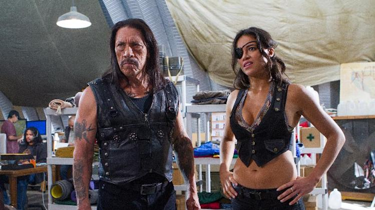 "This image released by Open Road Films shows Danny Trejo, left, and Michelle Rodriguez in a scene from ""Machete Kills."" (AP Photo/Open Road Films, Rico Torres)"