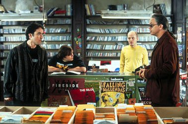 "Self-professed ""music junkies"" (left to right) Rob Gordon ( John Cusack ), Barry ( Jack Black ), and Dick ( Todd Louiso ) have little or no patience for customers such as Ian ( Tim Robbins , right) wh"