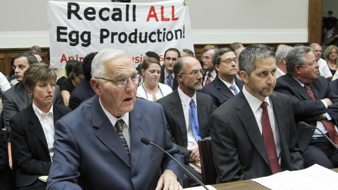 """FILE - In this Sept. 22, 2010, file photo protestors unfurl a banner on Capitol Hill in Washington as Wright County Egg owner Austin DeCoster, left, testifies  before the House Oversight and Investigations subcommittee hearing on The Outbreak of Salmonella in Eggs. An Iowa State University scientist found evidence that sick hens at farms owned by DeCoster were """"almost certainly"""" laying eggs contaminated with salmonella months before one of the nation's largest outbreaks of food-borne illness came to light, newly released records show. (AP Photo/Manuel Balce Ceneta)"""