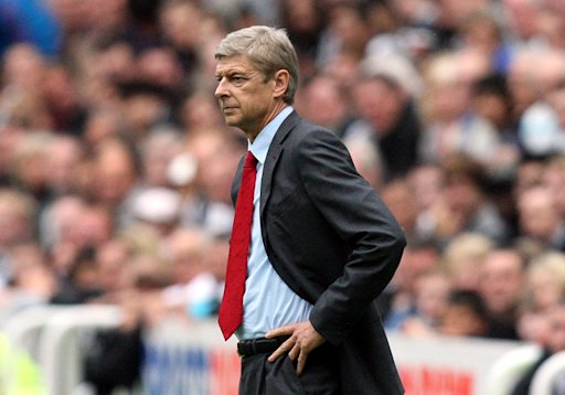 Arsenal's manager Arsene Wenger, reacts after Gervinho is sent off for hitting Newcastle United's Joey Barton during their English Premier League soccer match at St James' Park, Newcastle, England, Saturday, Aug. 13, 2011. (AP Photo/Scott Heppell) NO INTERNET/MOBILE USAGE WITHOUT FOOTBALL ASSOCIATION PREMIER LEAGUE(FAPL)LICENCE. CALL +44 (0) 20 7864 9121 or EMAIL info@football-dataco.com FOR DETAILS