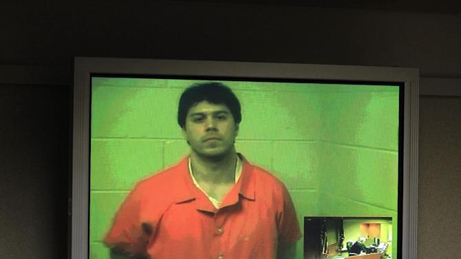 Raulie Casteel is arraigned via video at the 52-1 District Court in Novi, Mich., Friday, Nov. 9, 2012. The unemployed geologist suspected of two-dozen random shootings in southeastern Michigan was charged Friday with attempted murder after police matched his gun to bullet fragments recovered from victims' vehicles. Casteel, jailed since Monday in connection with a four-county spree that put drivers on edge for weeks, pleaded not guilty while appearing in court by video. (AP Photo/Carlos Osorio)