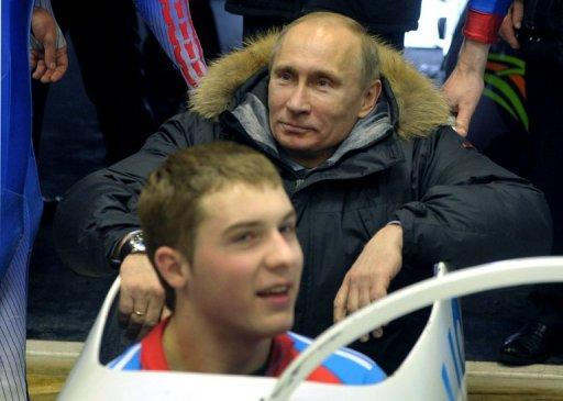 Vladimir Putin sits in a bobsleigh at a training session at Paramonovo bobsleigh and tobogganing center