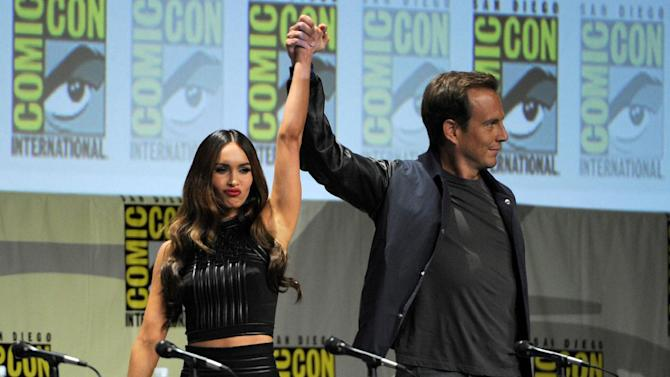 "Megan Fox, left, and Will Arnett attend the ""Paramount Pictures"" panel on Day 1 of Comic-Con International on Thursday, July 24, 2014, in San Diego. (Photo by Chris Pizzello/Invision/AP)"